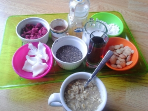 clockwise l to r dreamy instant oatmeal toppings: raspberries, cocoa powder, honey, mini 'mallows, almonds, maple syrup, chia seeds, coconut