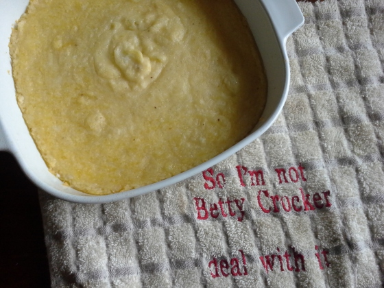 Baked Cheese Grits resting on a Christmas present from my daughters. Aren't they precious? Ha.